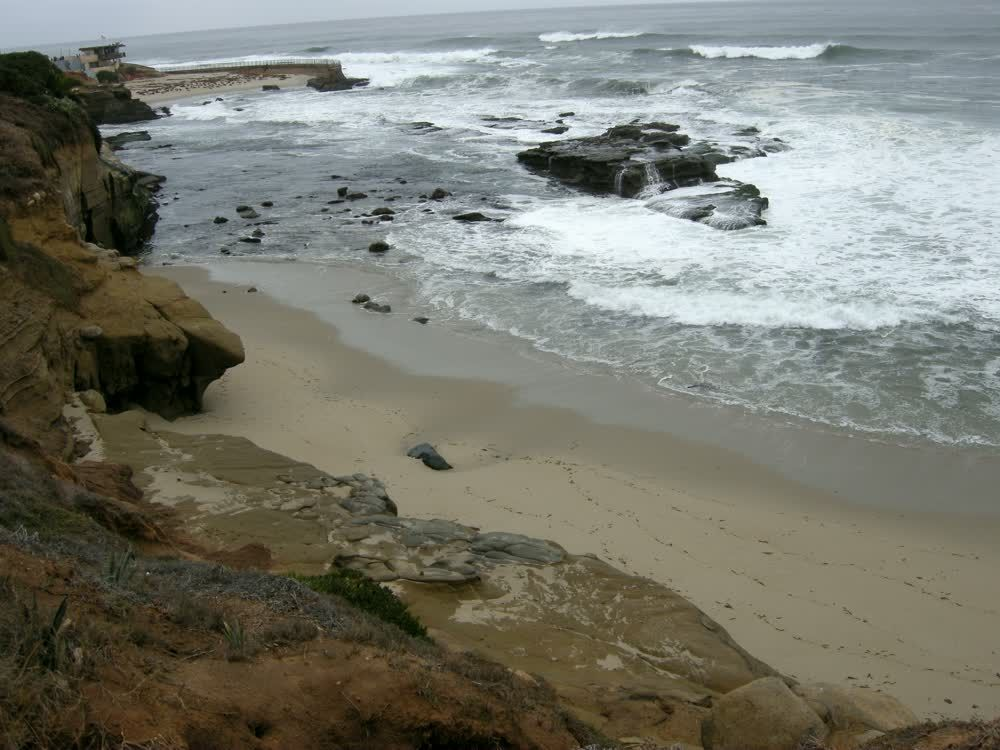 title: Beautiful Picturesque Scenery of Waves Crashing on the Rocks of La Jolla Beach in San Diego