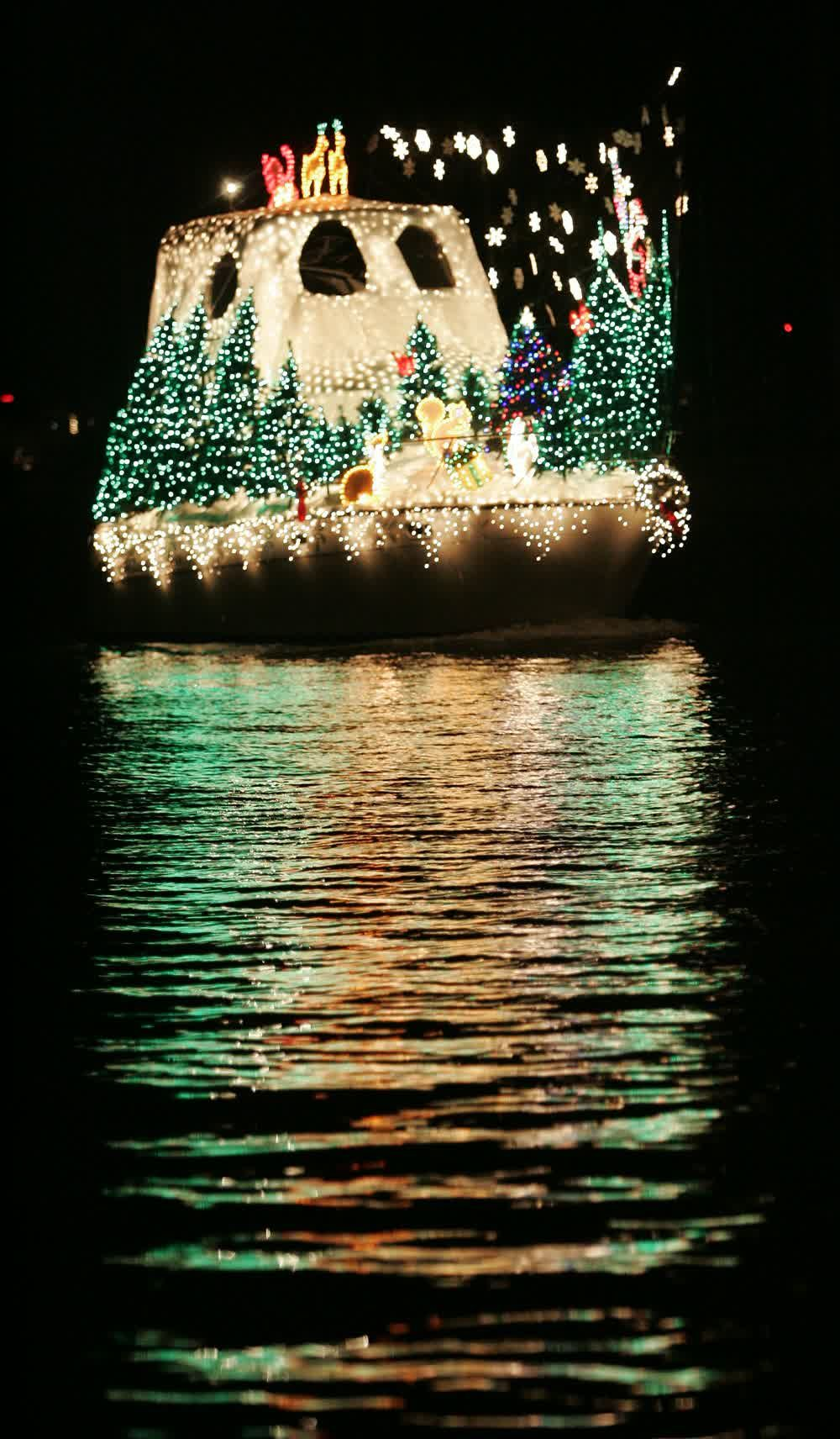 title: Beautifully Lit Up Boat with Christmas Light Decorations