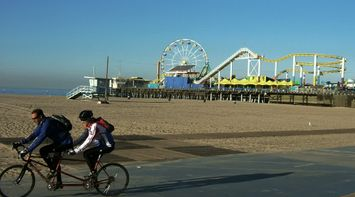 title: Biking on the Sant Monica Pier Beach by the Luna Park Games