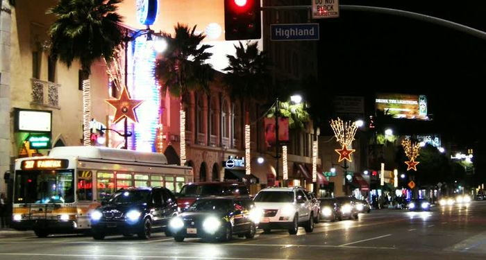title: Cars on the Street at Night on Hollywood Boulevard