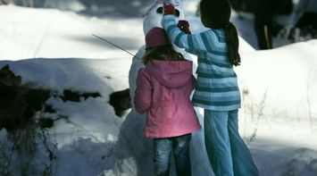 title: Children Building Snowman in the Snow of Palm Springs