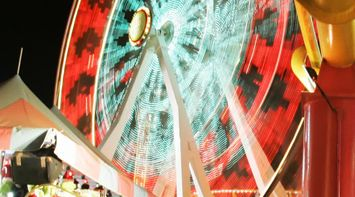 title: Colorful Lit Up Wheel at Sant Monica Luna Park in Los Angeles