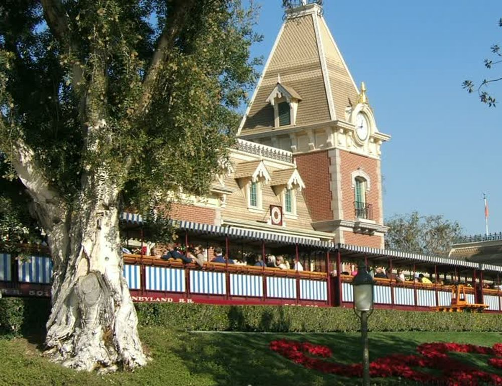 title: Crowded Seating Area Outside the Disneyland Historic Main Street Station