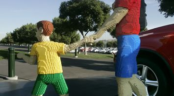 title: Father and Child Lego Statues at Legoland