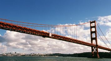 title: Golden Gate Bridge Under Fluffy White Dispersed Clouds in San Francisco