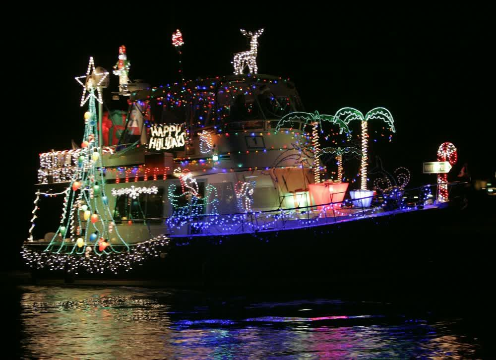title: Happy Holidays Boat Decoration at Night at Newport Beach