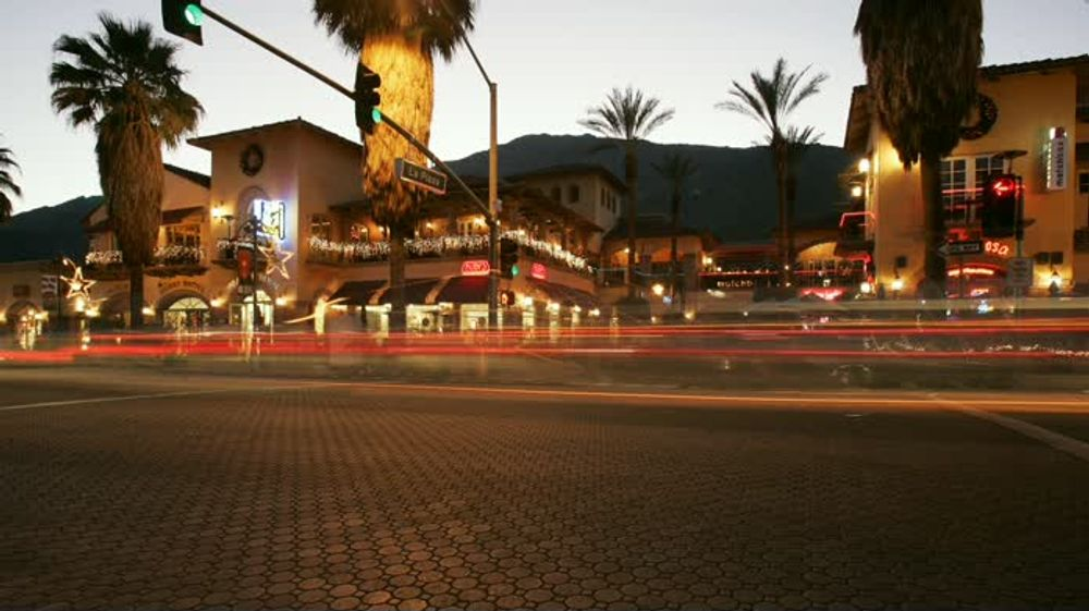 title: Lit Up La Plaza Street at Night in Palm Springs
