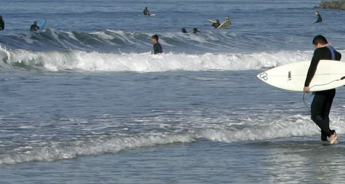 title: Surfers at Beach