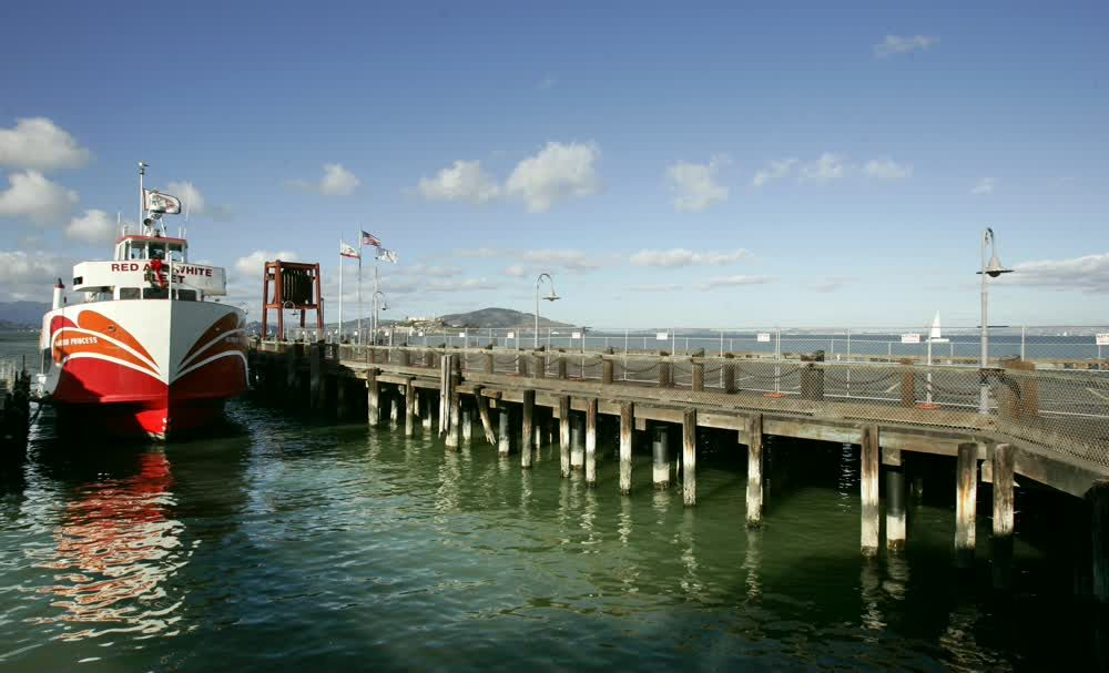 title: Red and White Fleet Boat on the Pier of San Francisco
