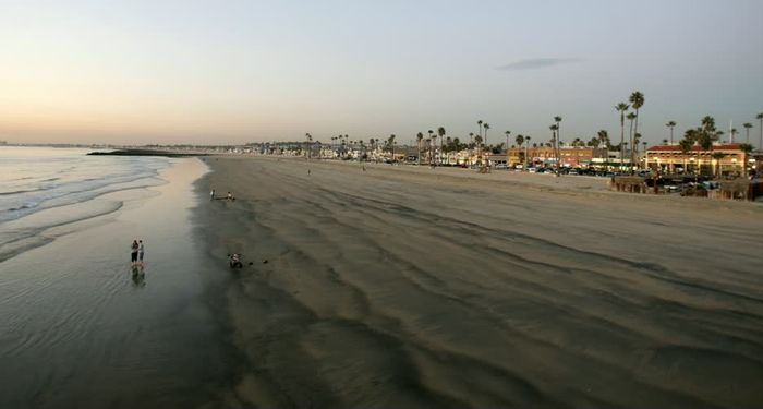 title: Sandy Shore of Newport Beach Scenery in California at Sunset