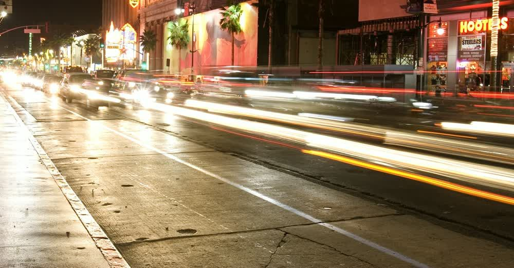title: Speeding Car Headlights Blur on the Street of Hollywood Boulevard