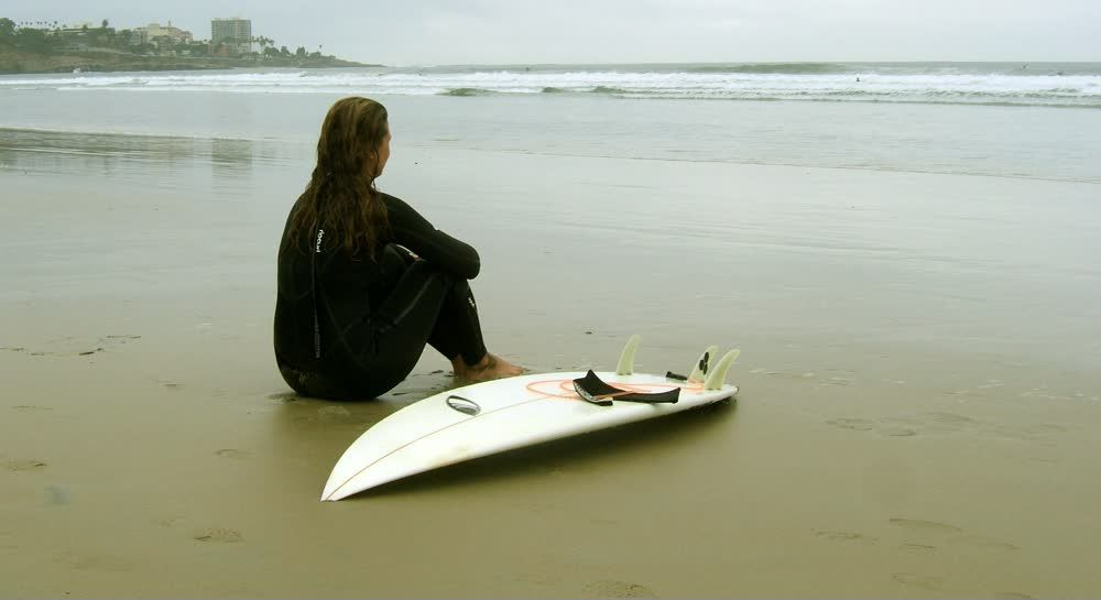 title: Surfer Waiting for Stronger Waves at the Beach La Jolla San Diego