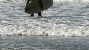 title: Surfers at Newport Beach