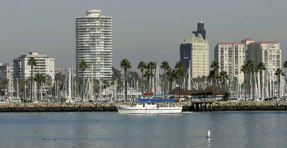 title: Tall Buildings on the Harbor and Boats near Queen Mary Hotel
