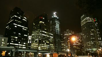title: Tall Office Buildings Lit Up at Night in Downtown San Francisco