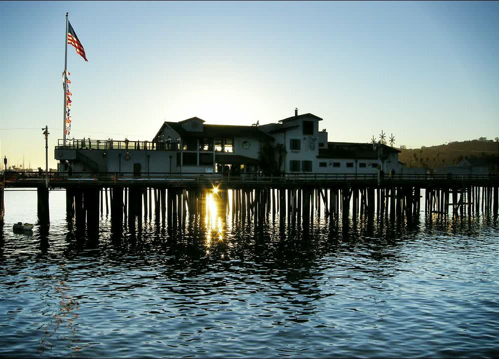 title: The American Flag Proudly Moving with the Wind on the Pier of Newport Beach