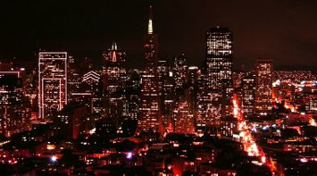 title: The City of San Francisco in Red Lights at Night