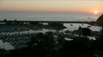 title: The Crowded Harbor with Many Boats in Orange County at Sunset