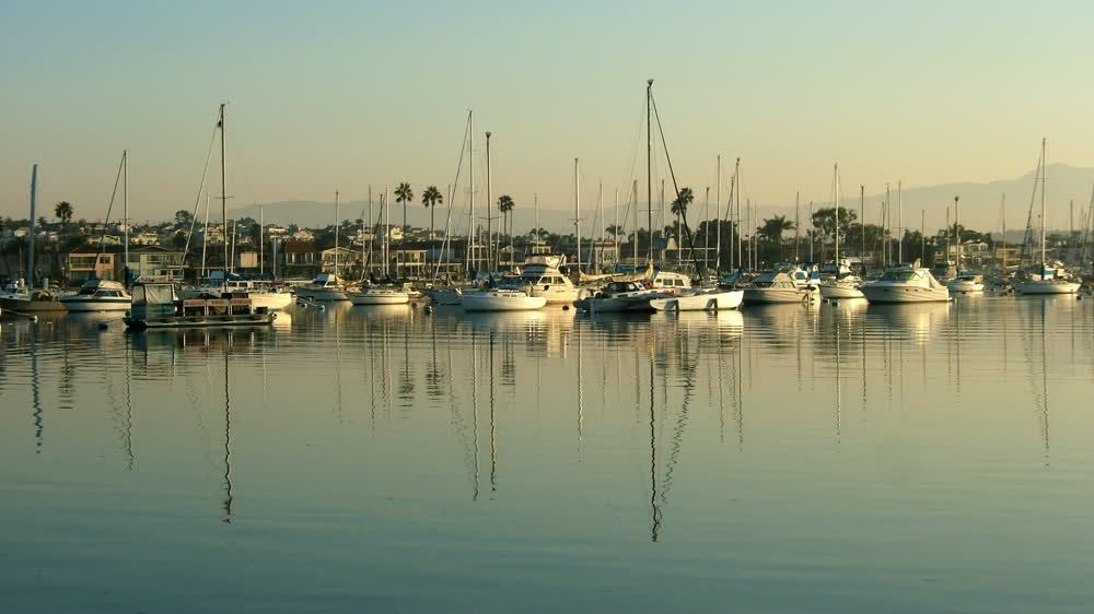 title: The Many Boats by the Pier of Stearns Wharf on Still Ocean Waters