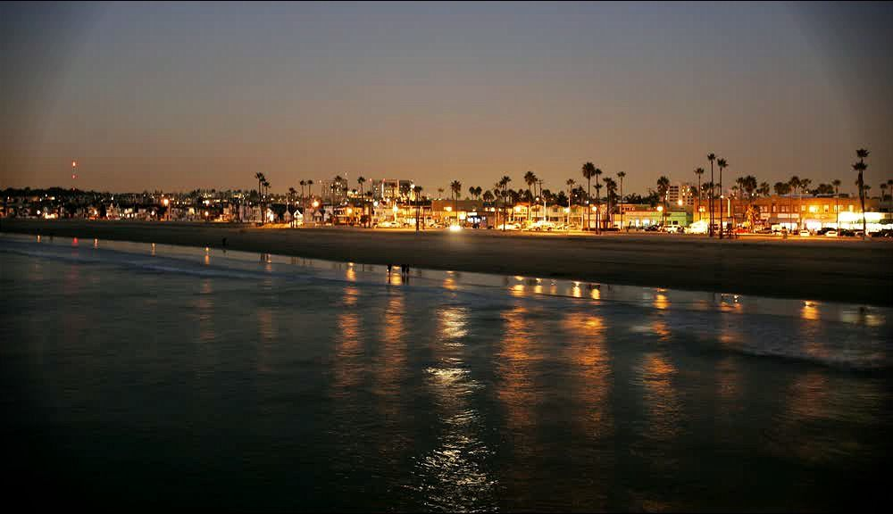 title: The Sandy Shores of Newport Beach at night