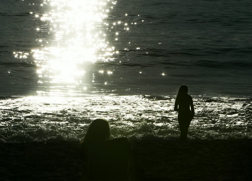 title: Walking on the Water Shore of Laguna Beach at Sunset in Southern Orange County