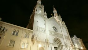 title: White St Peter and Paul s Church at night