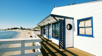 title: White and Blue House on the Malibu Beach Pier