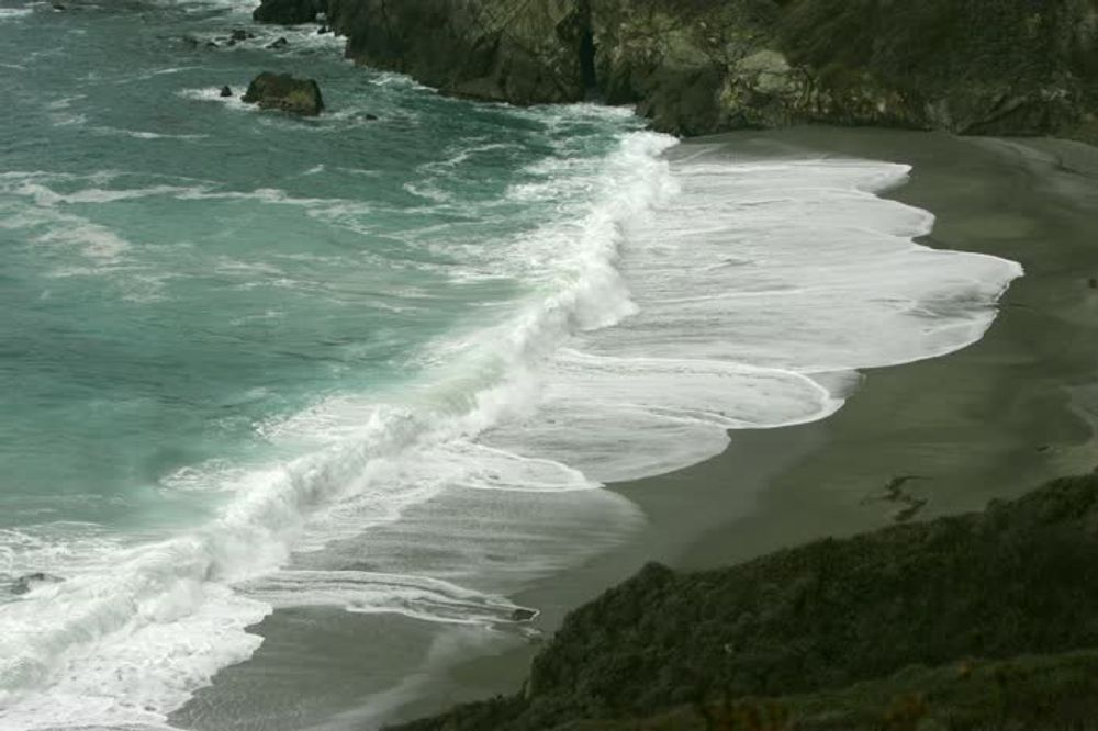 title: Crashing Live Waves on the Sandy Shore in California