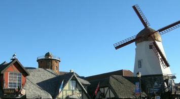 title: Danish Windmill on the Main Street of the Town