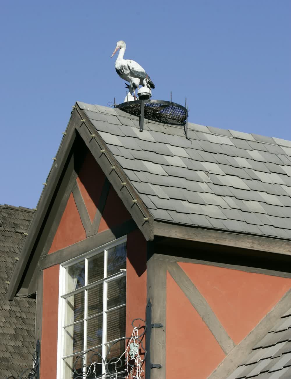 title: Stork Statue on Rooftop in Solvang