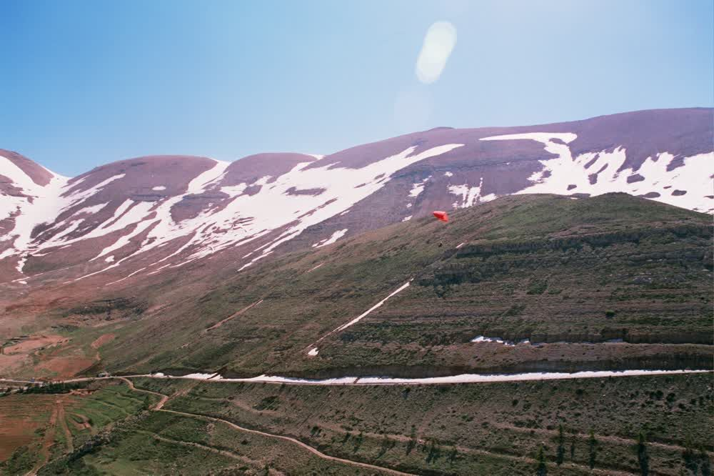 title: Adventurous Thrilling Paragliding over the Village Mountains