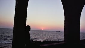 title: Enjoying the Purple Sunset on an Arch in Batroun