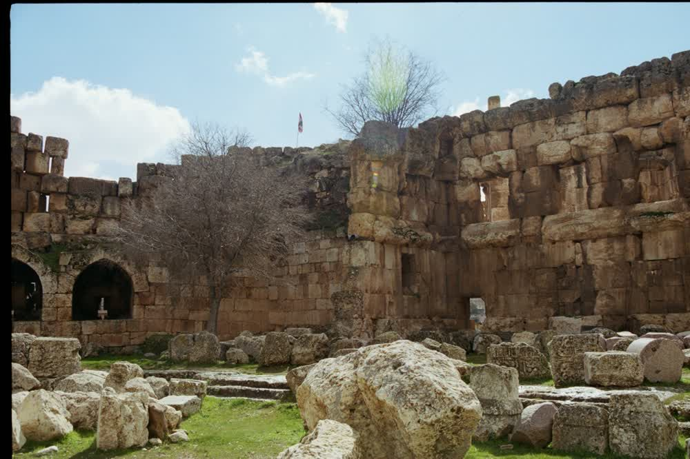 title: Lebanese Flag on Top of Temple Ruins