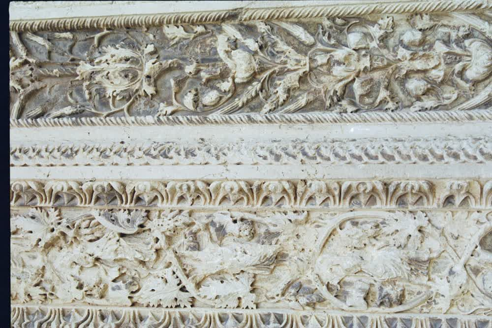 title: Ornate Stone Carvings on Rocks