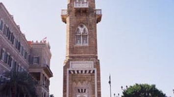 title: Pretty Clock Monument by the Garden in Downtown