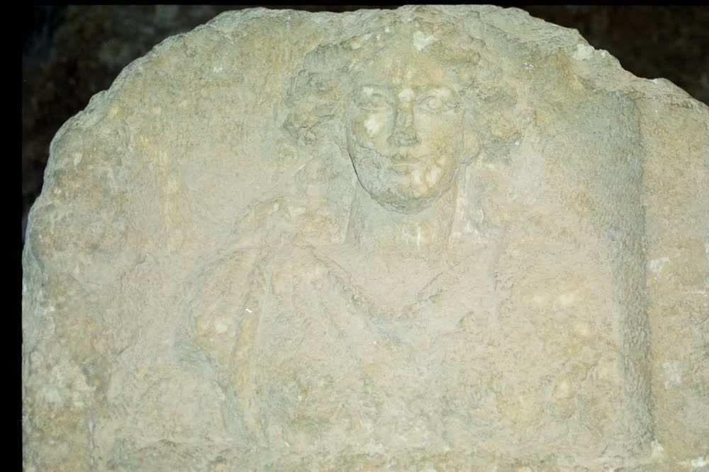 title: Roman Lady Preserved Carving in Stone Ruins