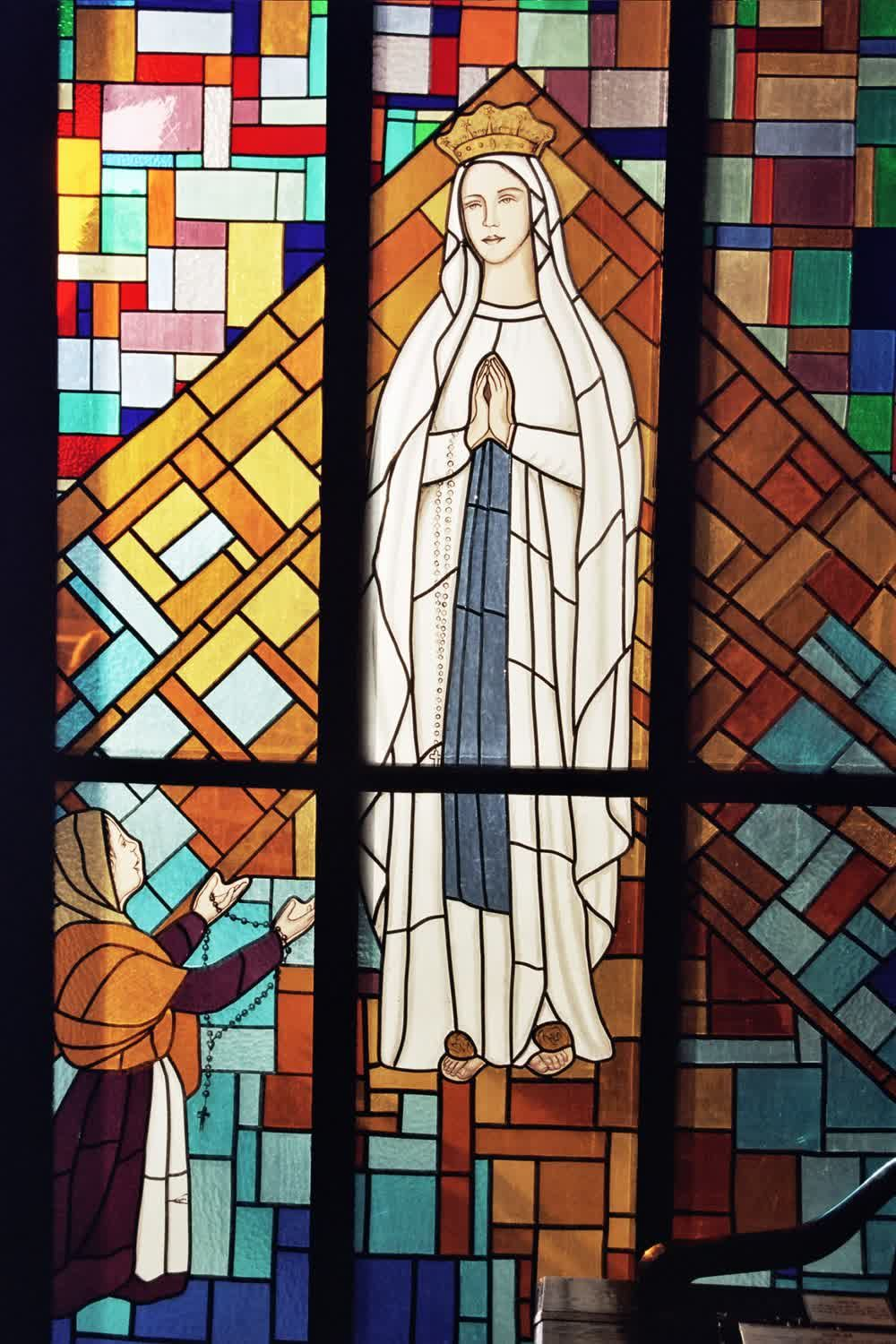 title: Saint Mary Mosaic of Stained Glass in Church