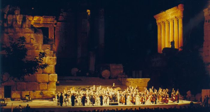 title: Synchronized Orchestra Playing on Stage During Festival