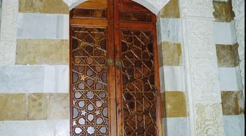 title: Tall Ornate Wooden Carved Closet at the Palace