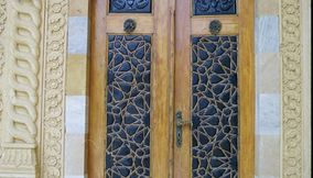 title: The Main Wooden Door Entrance with Carvings of Palace