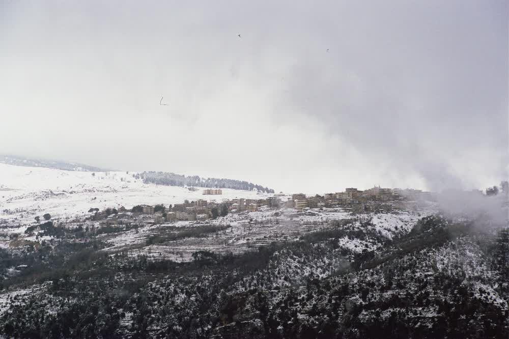 title: The Village on the Mountain Covered in Snow in Winter