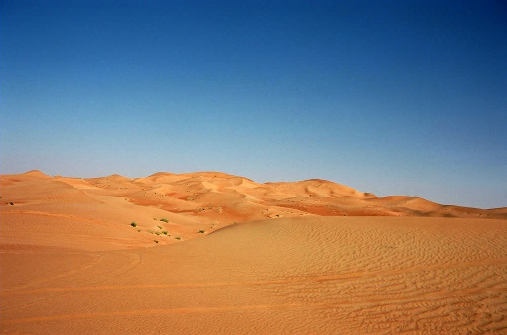 title: Desert Land and Blue Skies