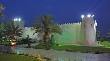 title: Abu Dhabi Palace in the Evening with Green and Purple Lighting Decor