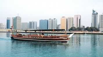 title: Antique Traditional Wooden Tour Boat for Touring the City by Sea
