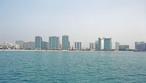 title: Buildings in Blue Gulf Sea
