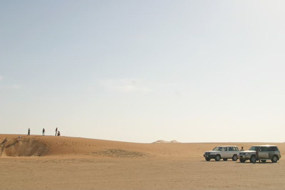 title: Cars in the Desert during the Day