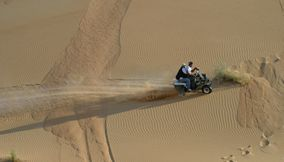 Riding the ATV in the desert