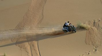 title: Leaving a Trail of Sand while Riding the ATV in the Desert