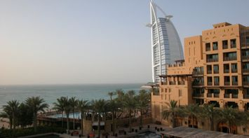 title: Private Pool and Lagoon of the Madinat Jumeirah on a Windy Day in Dubai UAE