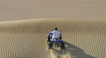 title: Riding a Large ATV Car for Fun in the Sands of Abu Dhabi Desert